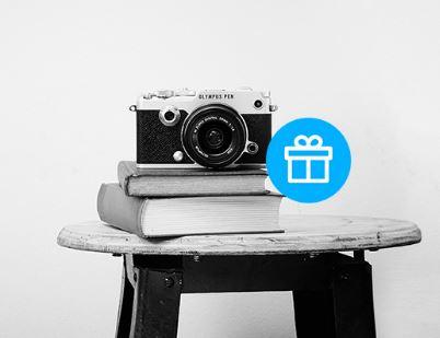 Акции в Связном сегодня. iPhone в подарок при покупке камер Olympus